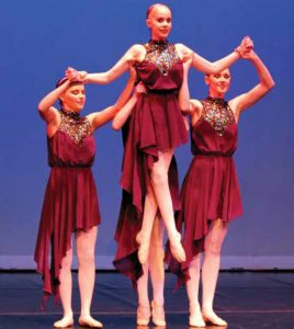 Anna (center) returns triumphant to ballet after her treatment for a brain tumor