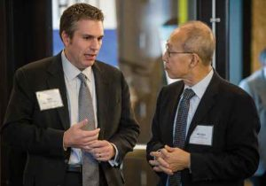 David Arons discusses brain tumour research and presentation material with US neurooncologist Dr. W.K. Alfred Yung at the annual National Brain Tumor Society Scientific Summit